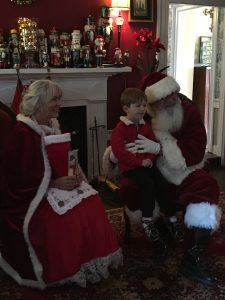 Photo of Santa & Mrs. Claus holding child on lap - Christmas in Virginia