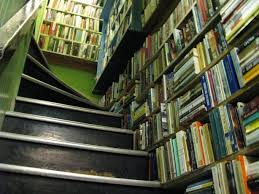 Image of a book-covered staircase at Daedalus Bookstore