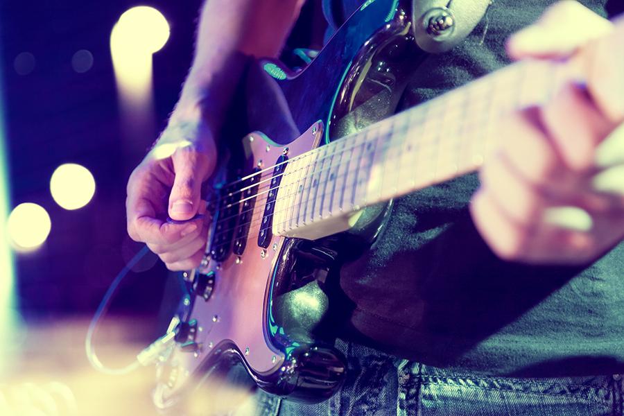 Guitarist playing music