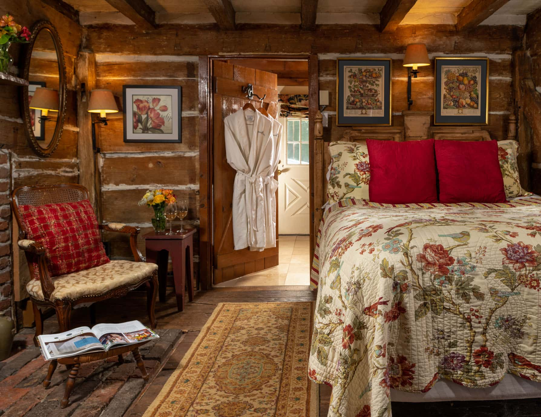 Rustic 17th century cabin with queen bed and seating area