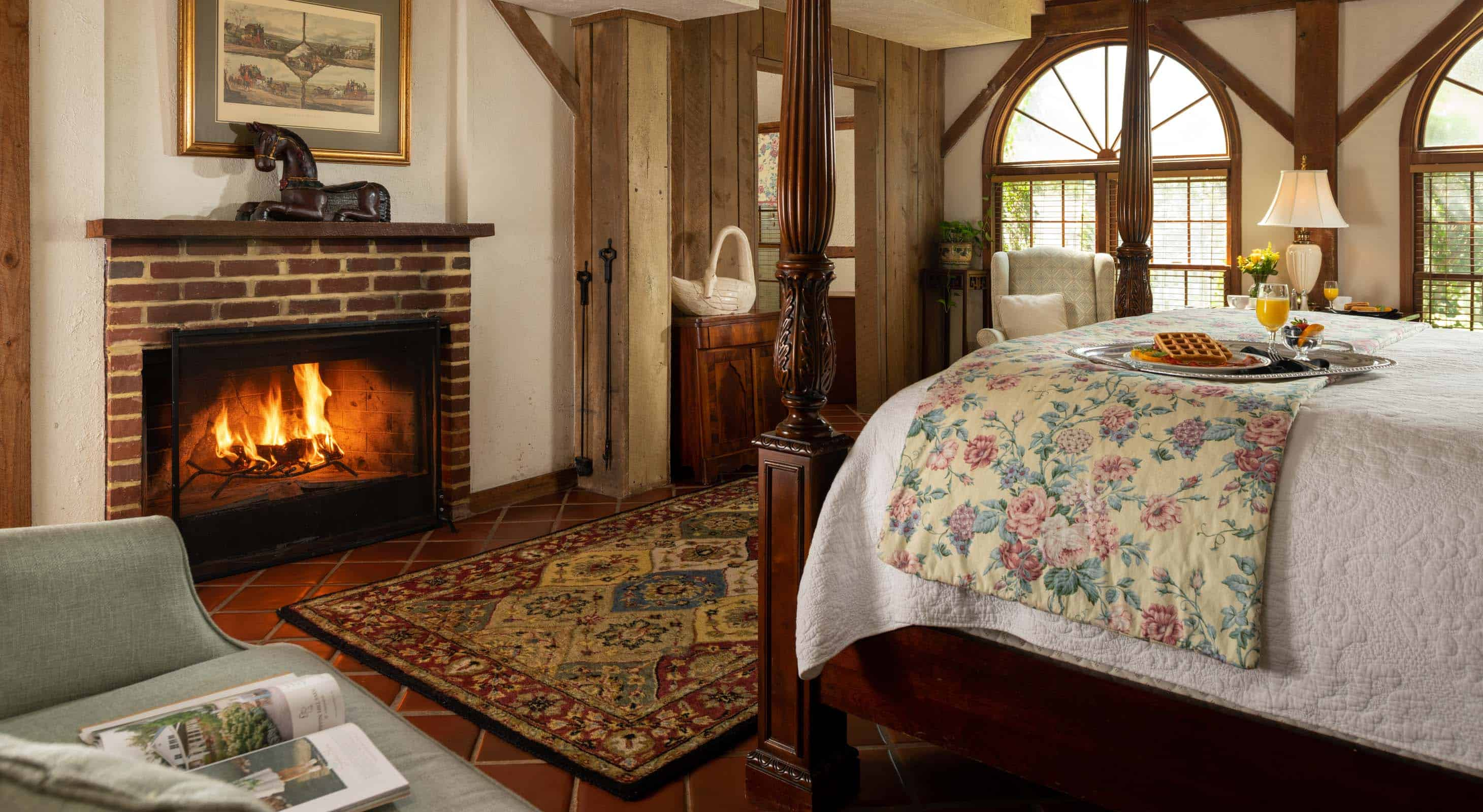 Wood-burning fireplace and seating area in the Carriage House Cottage