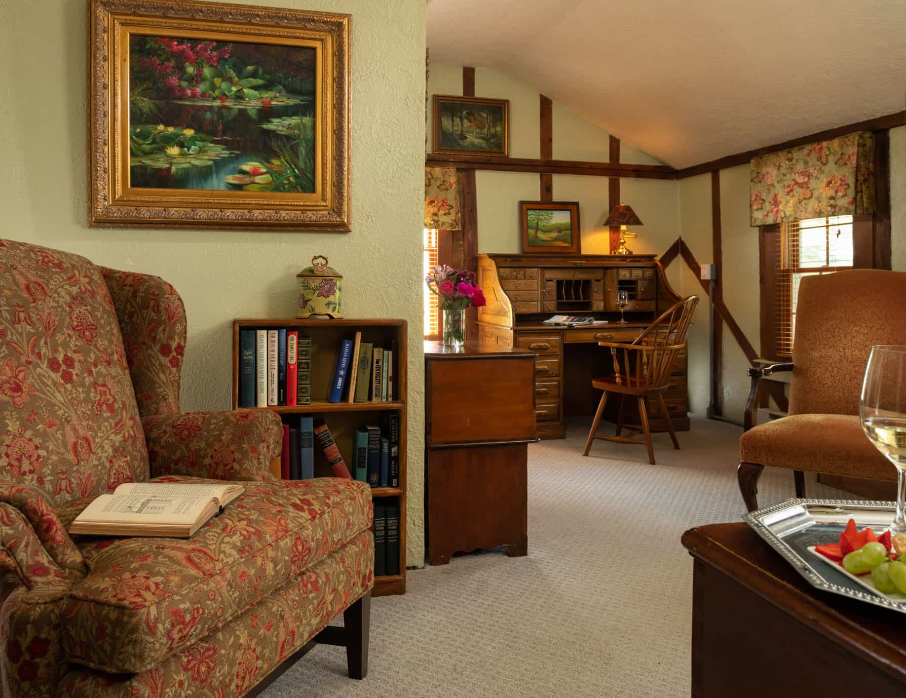 Seating area and small writing desk in a room with high ceilings