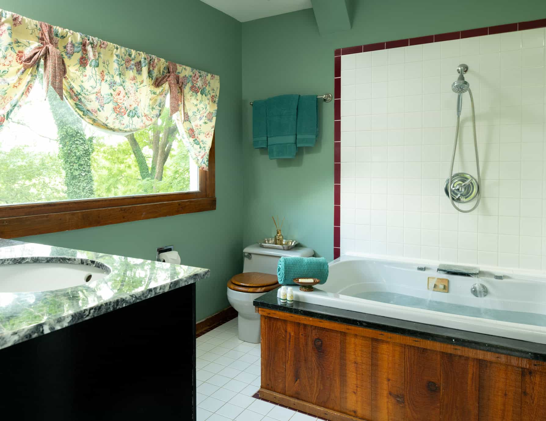 Bathroom with a large jetted tub and showerhead with a large window