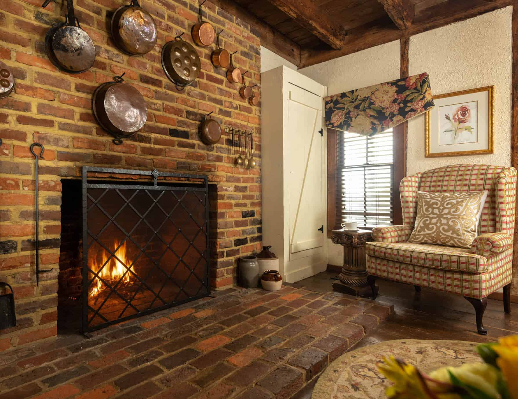 Brick wood-burning fireplace with a seating area