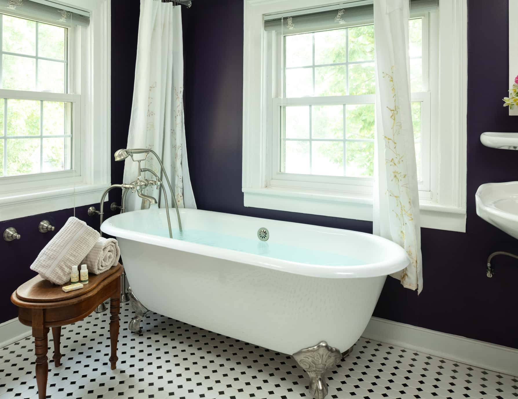 Clawfoot tub in a bathroom with garden views