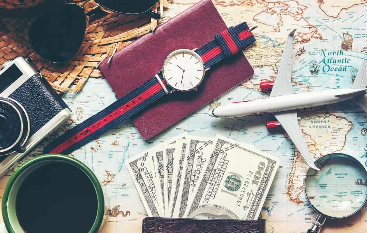 Travel items including cash, watch, passport, map