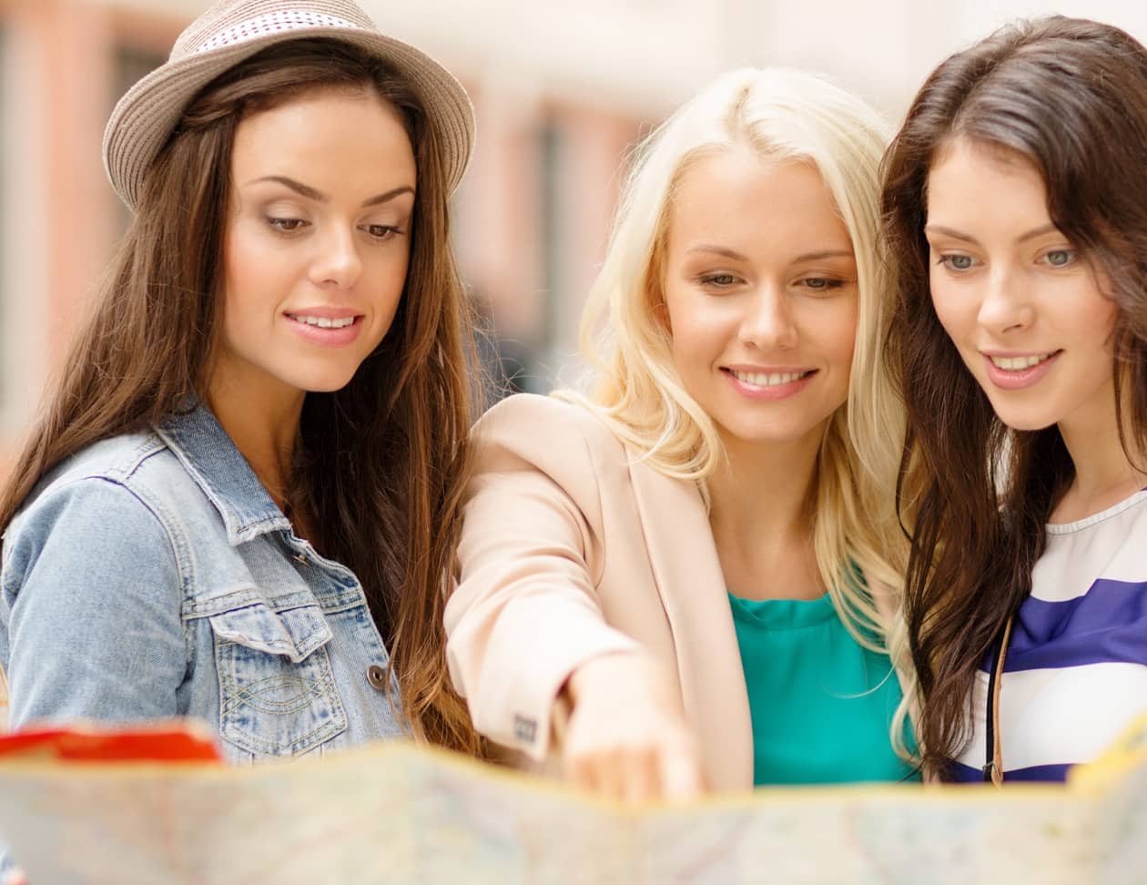 Three women looking at a map