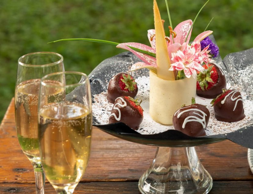Chocolate dipped strawberries, and two flutes of champagne