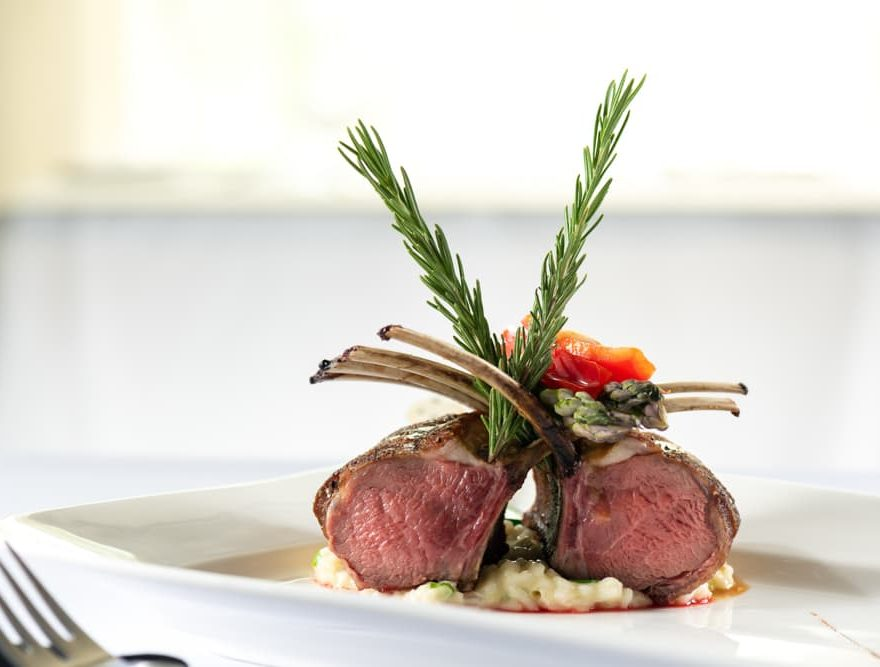 Rack of lamb with two sprigs of rosemary