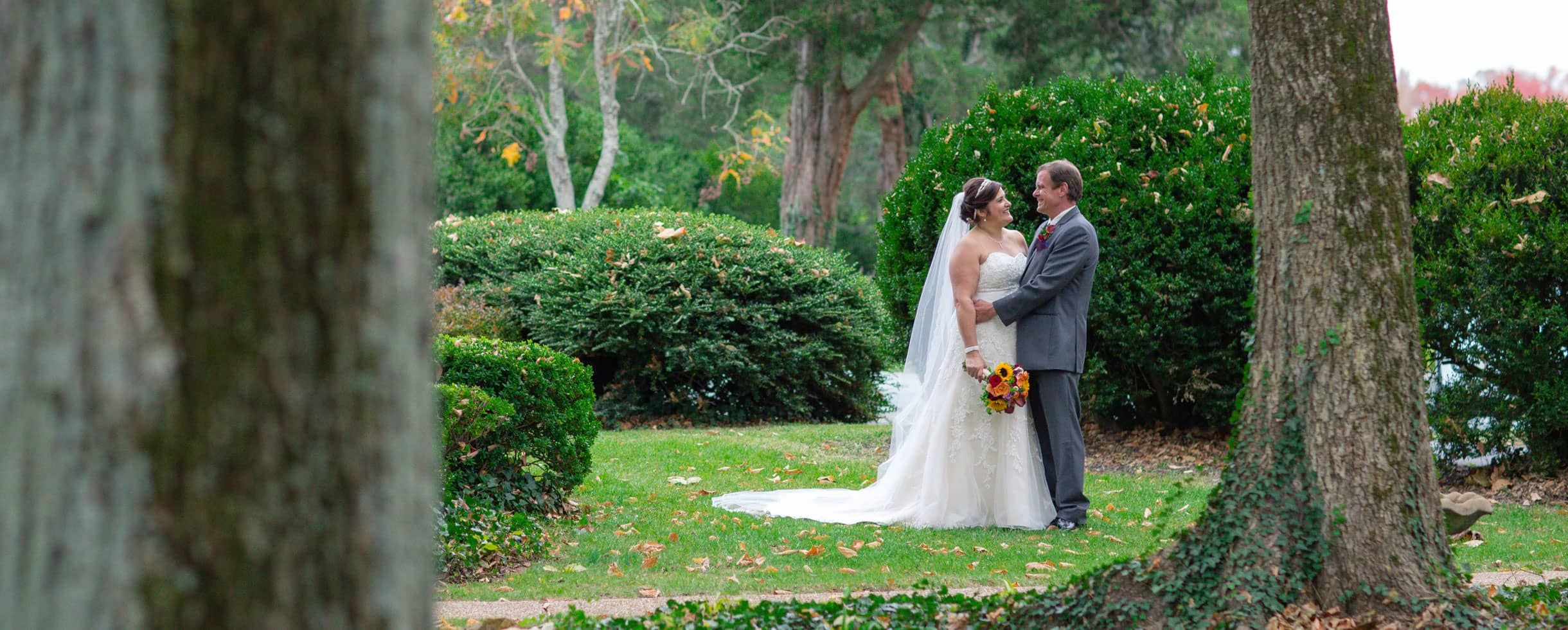 Bride and Groom standing in the Gardens at Prospect Hill