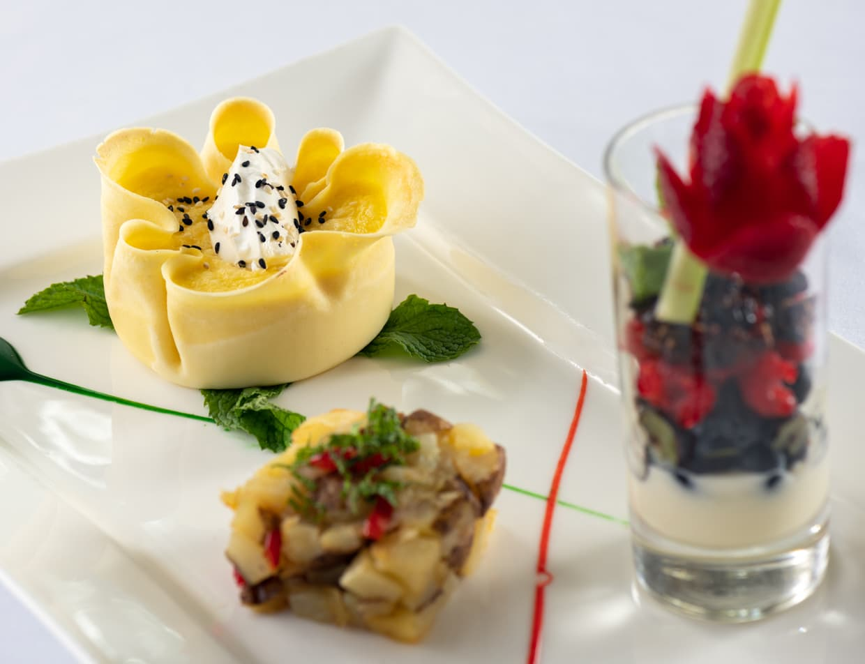 Breakfast trio with fruit potatoes and egg