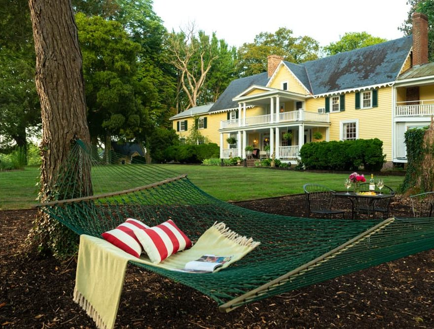 Hammock with a pillow and book at Prospect Hill Inn