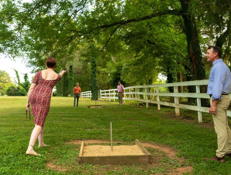 A group of guests playing horseshoes at Prospect Hill Inn