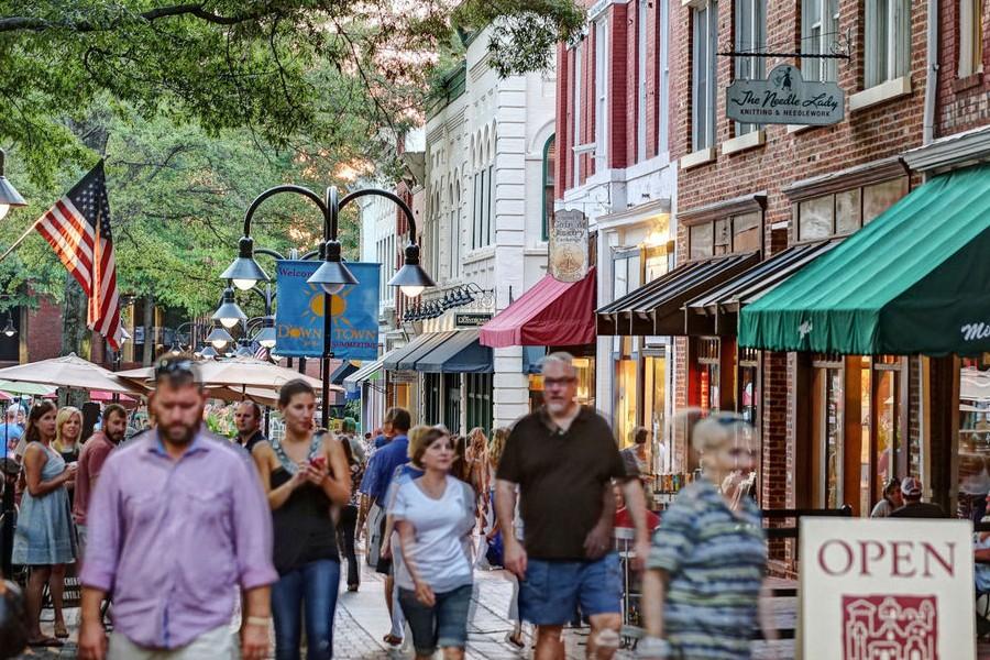 People walking along Charlottesville's pedestrian mall