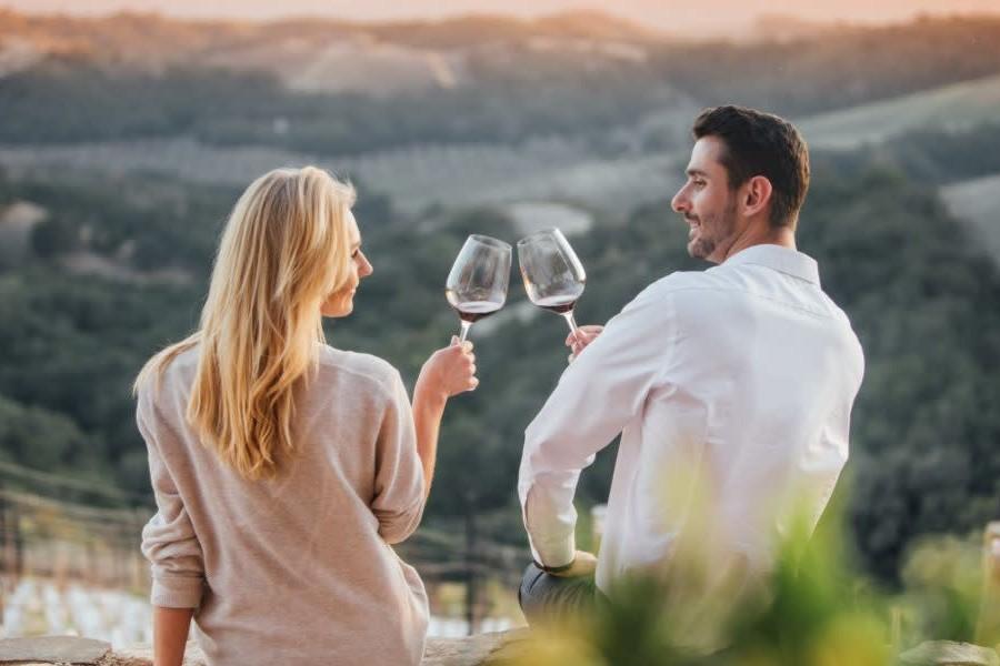 couple drinking wine overlooking Blue Ridge Mountains