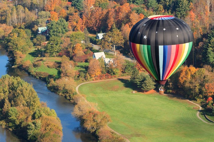 Airial view of hot air balloon floating over countryside