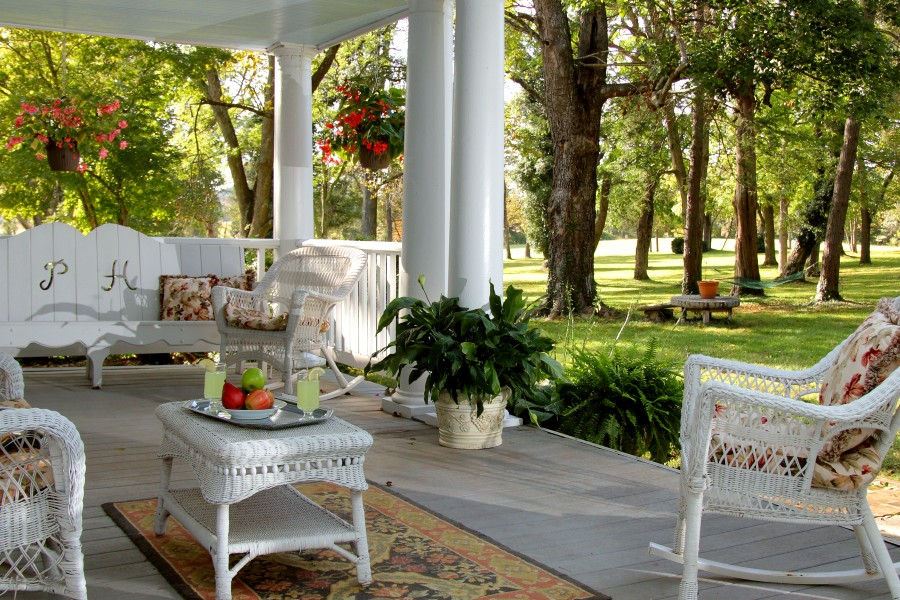 image of porch with chairs and trees in background